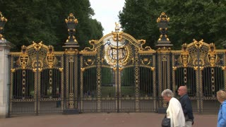 Tourists Walking Past Buckingham Palace Gates
