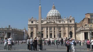 Tourists Walking Through St. Peters Square