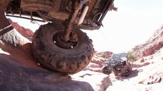 Towing a jeep stuck in rocks sideways