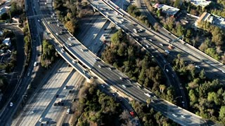 Traffic Along Freeway Overpass Aerial