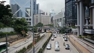 Traffic and Trams moving along the Queensway in Central, Hong Kong, China, T/lapse