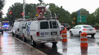 Traffic Driving Around News Trucks and Emergency Vehicles