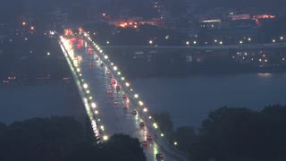Traffic Over Rainy Bridge at Dusk