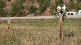 Traffic Passes Roadside Crosses