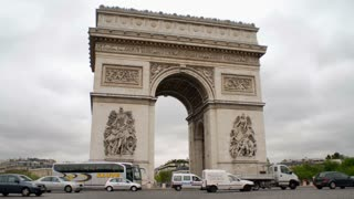 Traffic Quickly Passes Around Arc de Triomphe