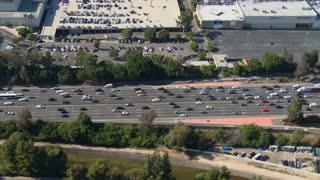 Trail Along Cars On Freeway Aerial