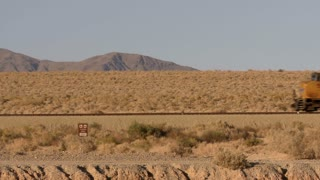 Train Passing Through Desert