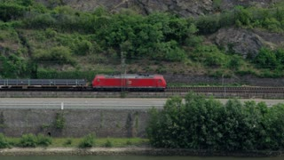 Train Running Along German River