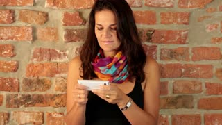 Trendy woman texting