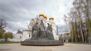 Trinity sculpture near Assumption Cathedral. Assumption Church timelapse hyperlapse or Dormition cathedral in summer, Yaroslavl city. city from the list Golden ring on the Volga river, Russia