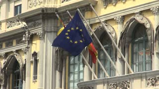 Trio of Flags Waving Outside Building in Spain