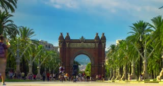 Triumphal arch Barcelona. City landscape. Time lapse of triumph arc in Barcelona. Old european architecture. Famous monument at city square. Travel destination. Tourists near main Barcelona landmark