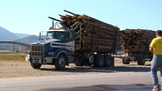 Truck Driver Returns To Log Truck