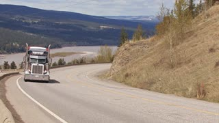 Truck Hauling Heavy Load Uphill in Canada