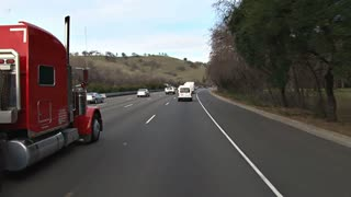 Truck Passing On The Highway