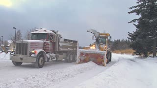 Trucks Clearing Snow off Road