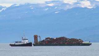 Tug Boat Approaches Scrap Metal Barge