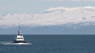 Tug Boat Coming From Icy Mountains