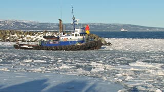 Tug Boat Going Through Icy Waters