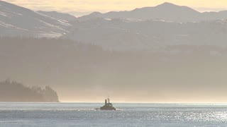 Tug Boat Heads Into Glowing Haze