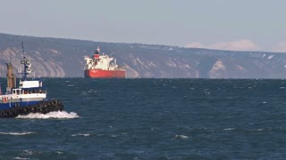Tug Boat Passing Oil Tanker By Coast