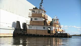 Tugboat Attached to Barge