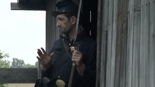 two civil war union soldiers meet by barn