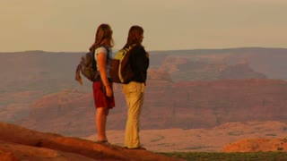 Two Female Hikers On Turret Arch Long Lens