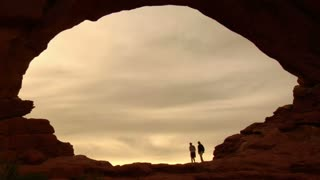 Two Female Hikers On Turret Arch Silhouettes