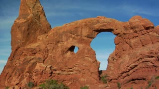 Two Female Hikers On Turret Arch Tilt Down