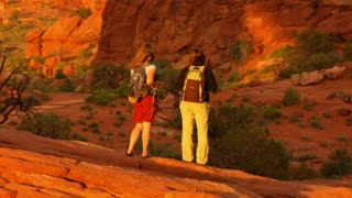 Two Female Hikers On Turret Arch Zoom Out Up