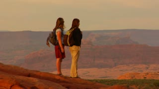 Two Female Hikers On Turret Arch Zoom Out