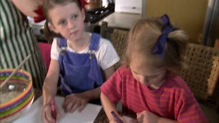 Two Girls Coloring on Paper 2
