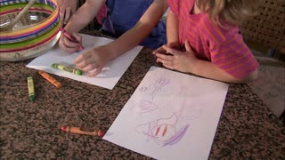 Two Girls Coloring on Paper 4