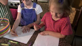 Two Girls Coloring on Paper