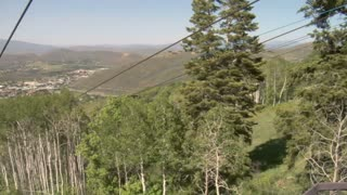Two Girls Go Down A Mountain Zipline