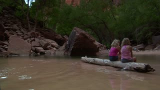 Two Girls On A Log In Shallow Water, Redrock Near