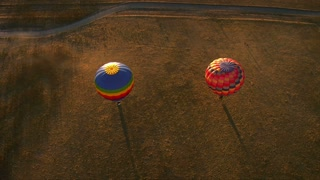 Two Hot Air Balloons With Long Shadows Shot From Above