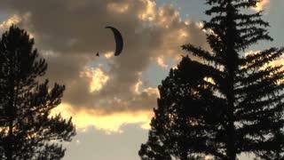 Two Parachuters Spiraling Towards Horizon