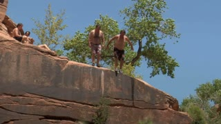 Two Rotund Men Jumped Off Red Rock Cliffs Into Water