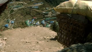 Two Sherpa Porters Walking into Village