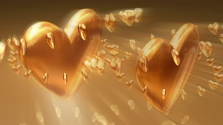 Two Spinning Gold Heart
