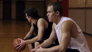 Two Sweaty Basketball Players Sitting