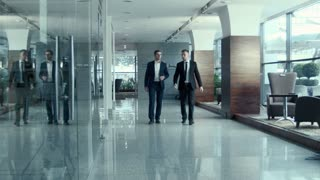 Two walking businessman indoor