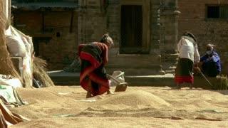 Two Women Sort Through Sand in Village in Nepal