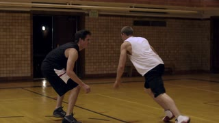 Two Young Men Playing Basketball 9