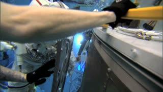 Underwater Astronaut Installing Panel