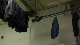 Uniforms Hanging On Mechanical Line
