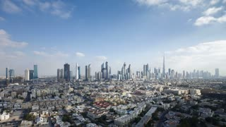 United Arab Emirates, Dubai, elevated view of the new Dubai skyline of modern architecture and skyscrappers on Sheikh Zayed Road - T/lapse
