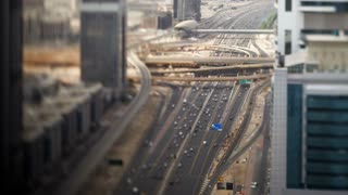 United Arab Emirates, Dubai, Timelapse over Sheikh Zayed Rd, showing the new MTR track and station system and the Burj Khalifa, the worlds tallest building